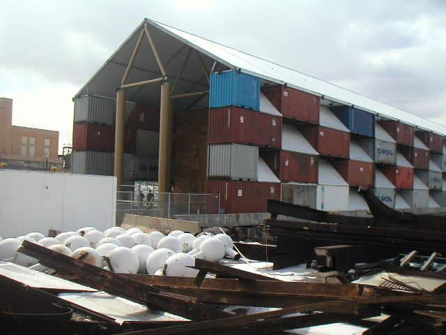 Shigeru Ban, The Nomadic Museum. Shipping container walls, steel roof supported by cardboard trusses